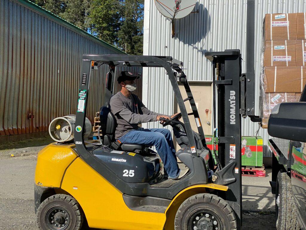 AC Yakutat Manager loading food boxes